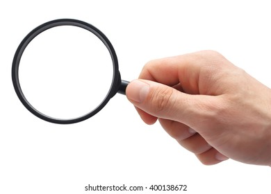 Man's hand with magnifying glass.
