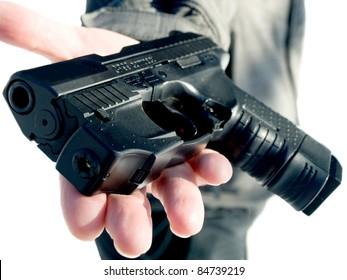 man's hand offering the gun