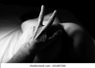 man's hand on the bare ass of female sex concept