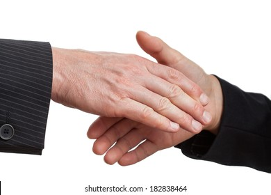 Man's hand on the top shows his domination in the handshake