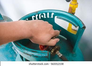 Man's hand operating valve of LPG