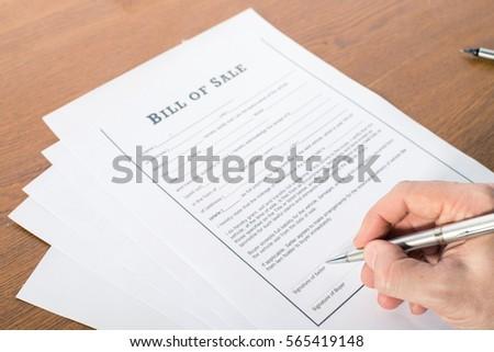 mans hand pen sign bill sale stock photo edit now 565419148