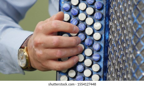 Man's Hand Plays the Blue Accordion