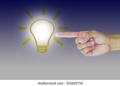 Man's hand pointing to light bulb, have an idea concept