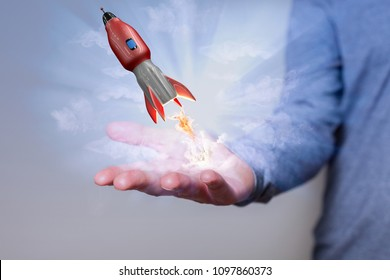 Mans hand with red flying rocket.