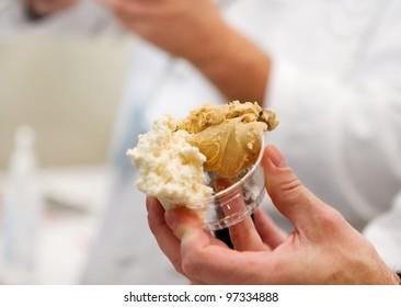 man's hand serving a customer frozen gelato
