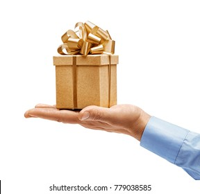 Man's hand in shirt giving golden gift isolated on white background. High resolution product. Close up