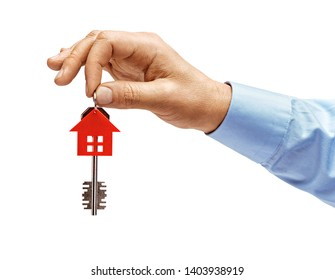Man's hand in shirt holds house keys isolated on white background. High resolution product. Close up.