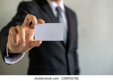 Man's hand showing business card,businessman holding blank visit card,Businessman showing blank business card isolated on white background.