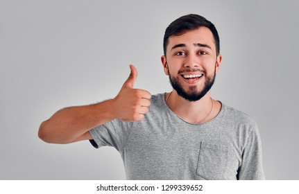 The man's hand shows a gesture of approval. Thumbs up. The hand shows gesture class. Everything is cool, you're done, praise, everything is OK, wonderful mood