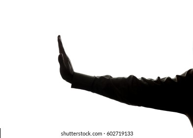 Man's hand shows a symbol of a stop, denial, disagreement - silhouette