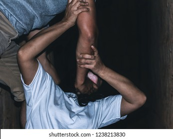 a man's hand is strangling a girl neck. stop domestic violence against women campaign.