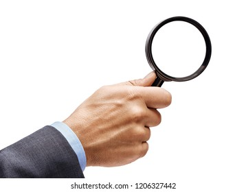 Man's hand in suit holding magnifying glass isolated on white background. Close up. High resolution product