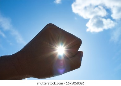 Man's hand and the sun