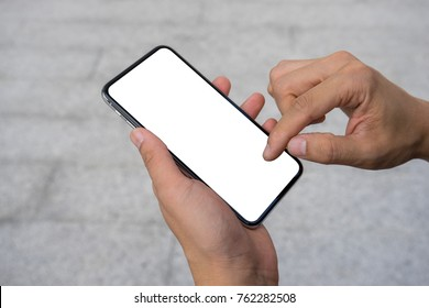 Man's hand using mobile smartphone with white screen. Mock up mobile