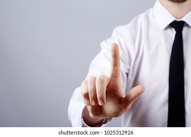 Man's hand wearing white shirt and tie showing a sign at studio background, close up, business concept, gestures, warning.