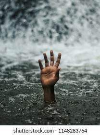 a man's hand who is drowning
