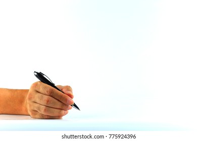 man's hand is write on the book, note book, isolated on white background, in concept of approval, authorize, writing, take note