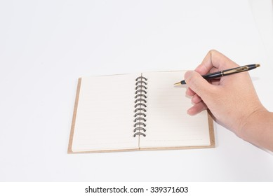 A man's hand  writing the empty notepad (notebook) on white background