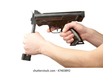 Man's hands charge a pneumatic pistol on a white background