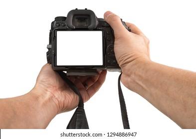 Man's hands holding modern DSLR isolated on white background