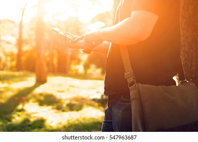 man's hands holding smart phone with blank copy space screen for text message or promotional content,male chatting in network on cell telephone while selective focus,vintage color
