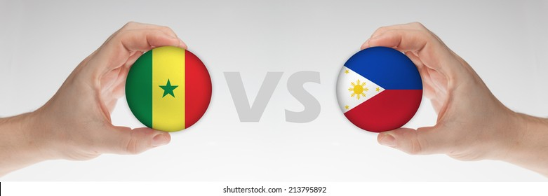 Man's hands holding styrofoam balls with Senegal and Philippines flag against the white background.