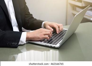 Man's hands typing on laptop. Internet surfing