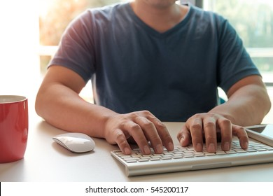 Man's hands using laptop for online shopping concept.