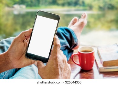 Man's hands using smart phone.