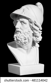 The man's head in a helmet in a classical style on a black background