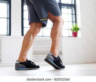 Man's legs in fitness shoes.