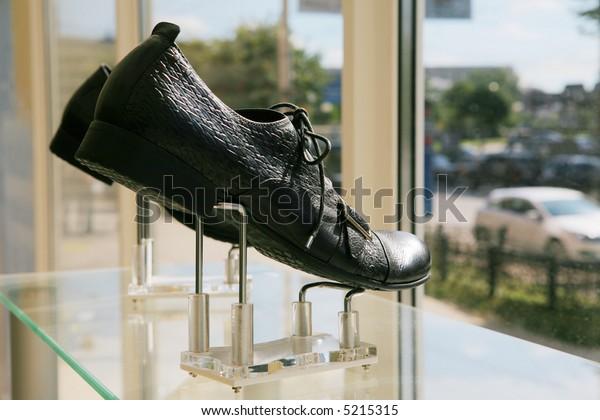 Man's low shoes on a show-window of shoe shop