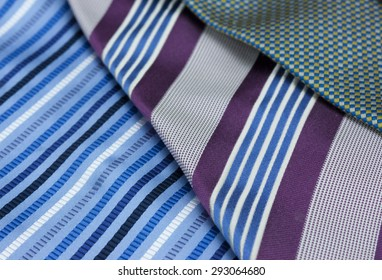 Man's neck tie laying on a black background