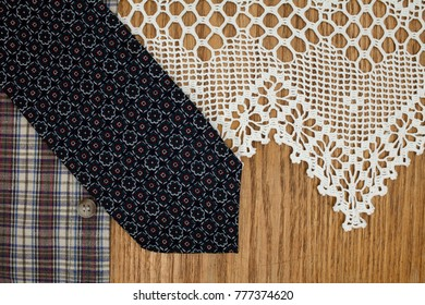 man's necktie, shirt, lace napkin conceptual image of a classic style in fashion