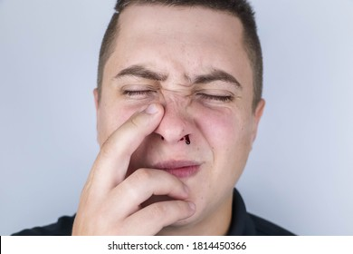 The man's nose started bleeding. High blood pressure caused blood vessels to rupture. A thin red trickle flows out of the sinuses. Consequences of vascular problems and severe stress