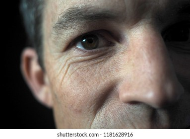 Man's portrait with dramatic light, close up on eye