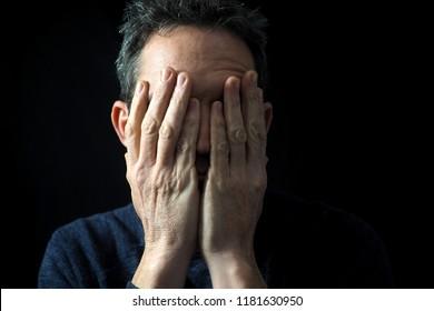 Man's portrait, holding head in frustration
