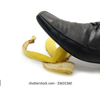 man's shoe about to step on a banana skin