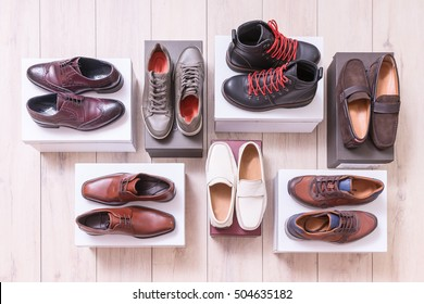 Man's shoe collection on a background.