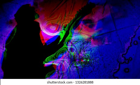 Man's silhouette playing guitar with psychedelic colors swirling about.