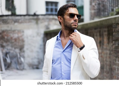 Man's style. dressing suit, shirt, glasses