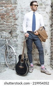 Man's style, dressing, suit, shirt, guitar