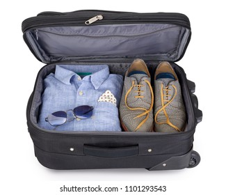 Man's suitcase packed for a short vacation or city trip