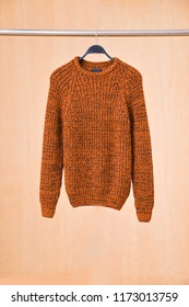 A man's sweater(t shirts) on hanging-wooden background