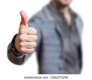 Man's thumb in a symbolic approval gesture thumbs up