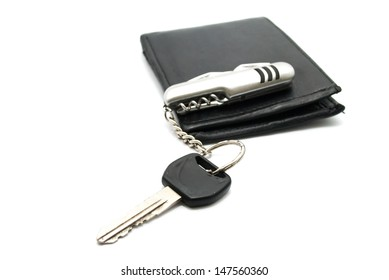 Man's Wallet and motorcycle keys, isolated on white
