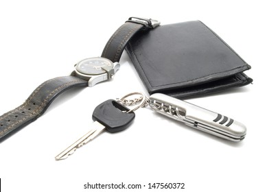 Man's Wallet,  motorcycle keys and wrist watch, isolated on white