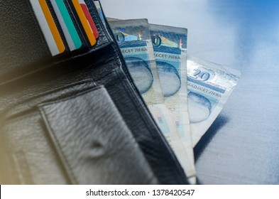 A man's wallet with some Bulgarian money in it and some bank cards. Macro image.