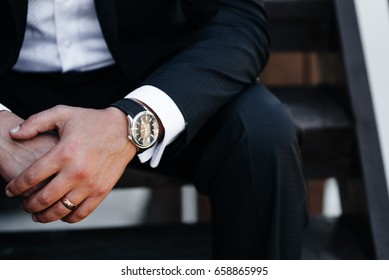 Man's watch on hand. Classic men's accessories and style.
